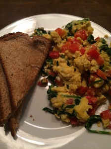 Greek egg scramble: lots of spinach and red pepper with a little feta thrown into the mix.