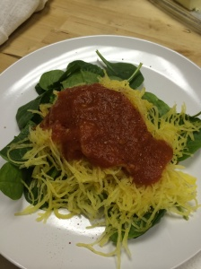 Roasted spaghetti squash on a bed of baby spinach. Fave right now.